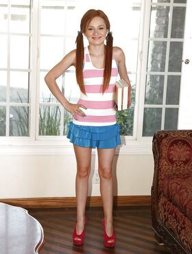 Jenny Anderson is a skinny redheaded